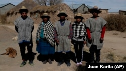 Members of the Choque family, from left, Jose, Evarista Flores, Rufino, Abelina and Abdon, pose for a photo in the Urus del Lago Poopo indigenous community, in Punaca, Bolivia, Sunday, May 23, 2021.
