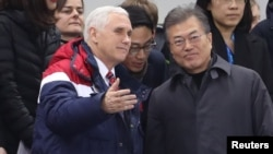 U.S. Vice President Mike Pence and South Korea's President Moon Jae-in attend a speed skating event at the Pyeongchang 2018 Winter Olympics, in Gangneung, South Korea, Feb. 10, 2018.