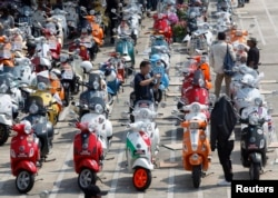 FILE - Vespa scooters are parked outside Bangkok city hall to celebrate Vespa's 65th anniversary in Thailand, in Bangkok.