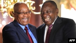 FILE: In this handout photograph released by the South African Government Communication and Information System (GCIS) on February 20, 2018, South Africa's President Cyril Ramaphosa (R) shakes hands with his predecessor Jacob Zuma at a farewell cocktail function for Zuma.
