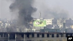Serangan bom mobil dan ledakan lainnya mengguncang Kabul hari Senin pagi di dekat gedung parlemen Afghanistan (21/1).