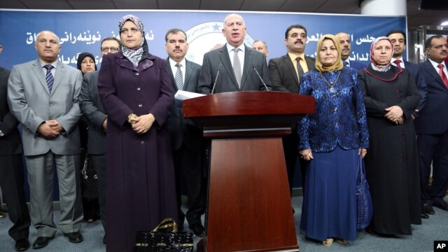 Iraqi former Parliament speaker and the chairman of the Sunni Arab Coalition Osama al-Nujaifi, center, speaks to the media during a press conference in Baghdad, Iraq, July 13, 2014.