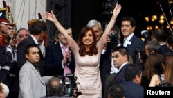 Argentina's President Cristina Fernandez greets supporters as she arrives for the opening session of the 133rd legislative term of Congress in Buenos Aires, March 1, 2015.