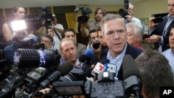 Republican presidential candidate, former Florida Gov. Jeb Bush, takes questions from the news media following a town hall at La Progresiva Presbyterian School, Tuesday, Sept. 1, 2015, in Miami.