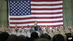 President Barack Obama speaks to troops at a rally during an unannounced visit at Bagram Air Field in Afghanistan.
