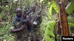 M23 rebel fighters are pictured as they withdraw near the town of Sake, some 42 km west of Goma on Nov. 30, 2012.