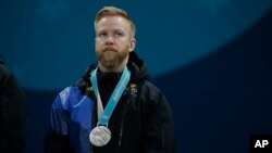 Silver medal winner Sweden's Niklas Edin stands on the podium during the men's curling venue ceremony at the 2018 Winter Olympics in Gangneung, South Korea, Feb. 24, 2018.