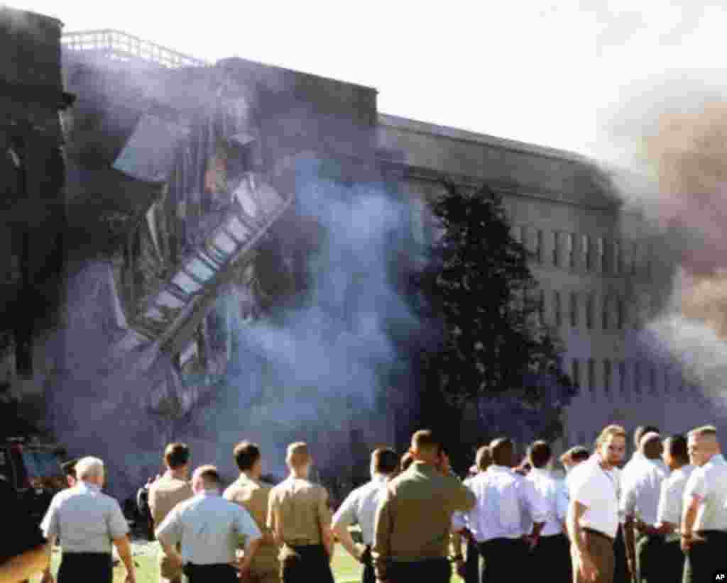The Pentagon is seen Tuesday, Sept. 11, 2001, after a direct devastating hit on the building by an aircraft. (AP Photo/ Hillery Smith Garrison)