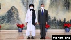2021年7月28日中國國務委員兼外交部長王毅在中國天津會見阿富汗塔利班政治首腦毛拉·巴拉達爾