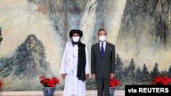 2021年7月28日中國外長王毅在天津會見塔利班政治首腦毛拉·巴拉達爾(路透社)