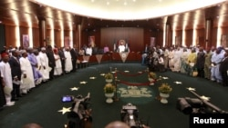 Nigeria's President Muhammadu Buhari swears in ministers into his cabinet in Abuja, Nov. 11, 2015. Buhari swore 36 ministers into his cabinet, five months after his inauguration.