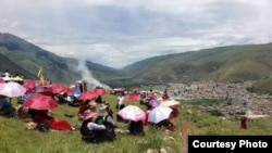 Tibetans in China's Sichuan province attempt to commemorate the Dalai Lama's birthday on July 6, 2013.