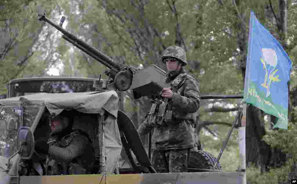 Hundreds of armed insurgents attacked a border guard encampment in eastern Ukraine as rebels nearby promised saftety for the officers if they surrendered the base and lay down arms, Slovyansk, June 2, 2014.