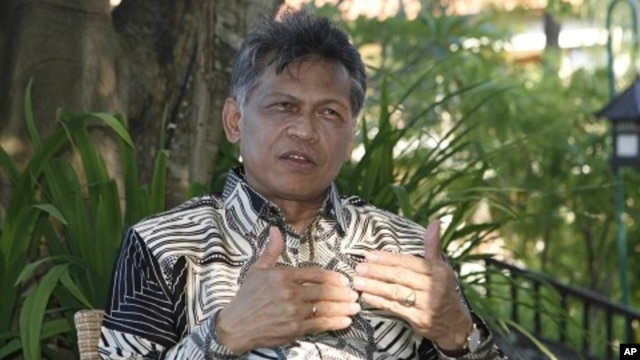 ASEAN Secretary-General Surin Pitsuwan speaks during an interview in Nusa Dua in Indonesia's resort island of Bali (file photo)