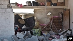 This picture taken Wednesday, Nov. 19, 2014 shows the interior of a destroyed home in Kobani, Syria. Here, Kurdish fighters backed by small numbers of Iraqi peshmerga forces and Syrian rebels, are locked in what they see as an existential battle against t