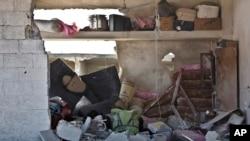 Hindurê xanîyeke wêrankirî li Kobanê
