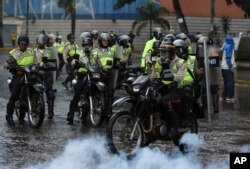 Police ride in to clear a protest in Caracas, Venezuela, June 28, 2017. Protests have continued almost daily for three months, with clashes between Maduro's foes and his supporters and security forces claiming at least 76 lives.