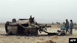 Hiện trường sau vụ nổ tại thị trấn Arghandab, ở ngoại ô thành phố Kandahar, ngày 27/2/2011