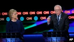 Kandidati za demokratsku predsedničku nominaciju Berni Sanders i Hilari Klinton održali su debatu u gradu Flintu, uoči primarnih izbora u Mičigenu.
