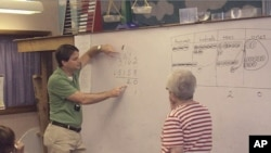 Scott Baldridge with a group of elementary school math teachers during a training session.