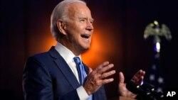 UMnu. Joseph Biden ukhuluma eWilmington, eDelaware ngoMgqibelo kusihlwa (AP Photo/Carolyn Kaster)