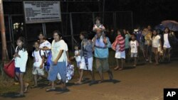 Residents of Tandag city, Surigao Del Sur province in southern Philippines, flee to higher grounds, following a 7.6-magnitude earthquake that struck eastern and southern parts of the country, August 31, 2012.