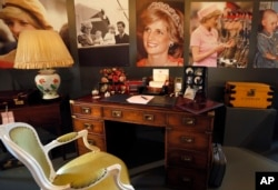 A display to mark the 20th anniversary of the death of Britain's Diana, Princess of Wales, a recreation of the desk where Princess Diana worked in her Sitting room at Kensington Palace, on display at Buckingham Palace in London, July 20, 2017.