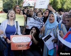 Women chant slogans as they gather to protest against sexual harassment in front of the opera house in Cairo, June 14, 2014, after a woman was sexually assaulted by a mob in Tahrir square.