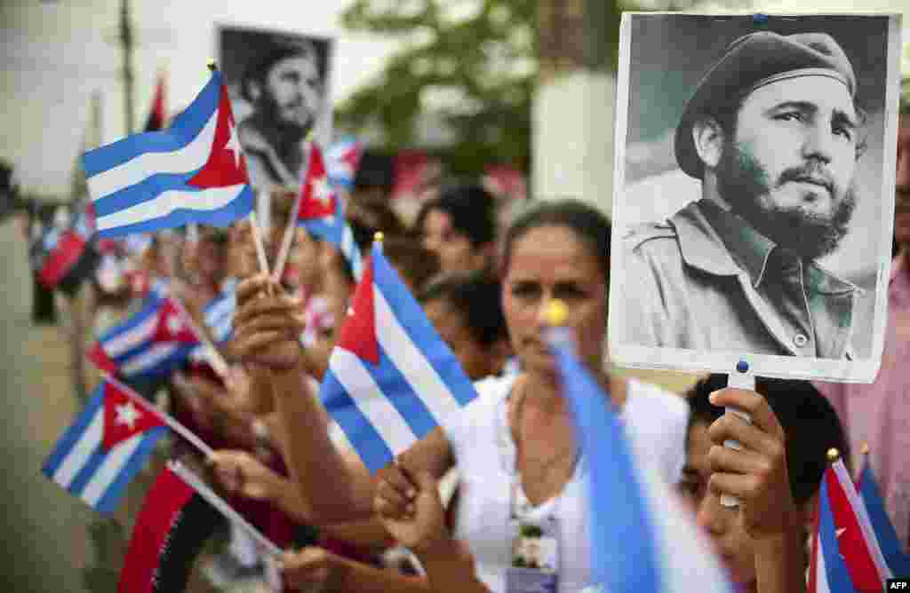 People wait for the ashes of Cuban leader Fidel Castro to be driven through the streets of Jimaguayu, Cuba, during their four-day journey across the island for the burial in Santiago de Cuba.