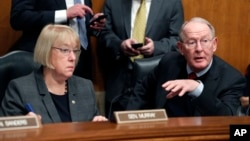 FILE - In this Jan. 31, 2017, photo, Senate Health, Education, Labor, and Pensions Committee Chairman Sen. Lamar Alexander, R-Tenn., and the committee's ranking member Sen. Patty Murray, D-Wash., are seen on Capitol Hill in Washington.