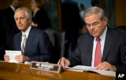 FILE - Senate Foreign Relations Committee Chairman Bob Corker, left, and ranking member Robert Menendez express concern about upheaval in Yemen.