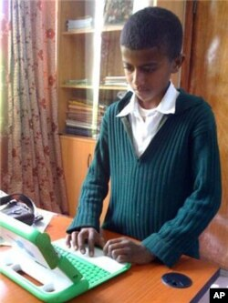 An Ethiopian boy uses the rugged, Internet-connected laptop computer designed and distributed by 'One Laptop Per Child'.