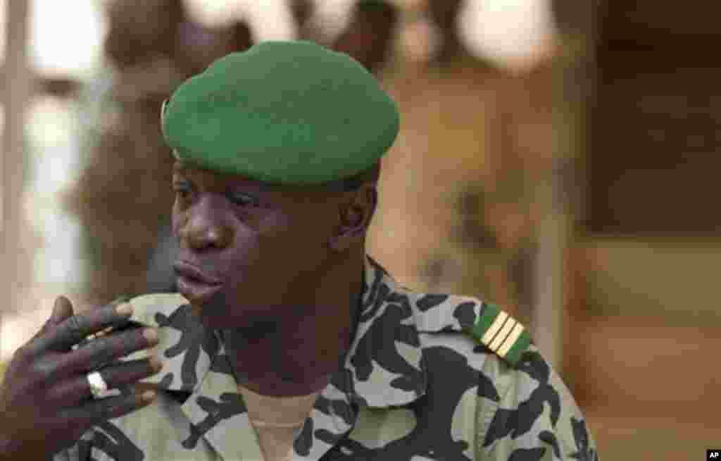 Coup leader Capt. Amadou Haya Sanogo addresses the press at junta headquarters in Kati, outside Bamako, Mali Friday, March 30, 2012.