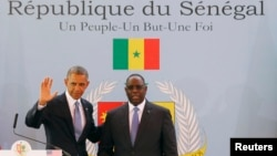 U.S. President Barack Obama participates in a joint news conference with Senegal's President Macky Sall at the Presidential Palace in Dakar, Senegal, June 27, 2013.