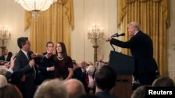 年終報導: 爭論不休 總統與媒體的2018