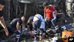 Emergency services rescue victims from overturned train cars near a village in Tekirdag province, Turkey, July 8, 2018.