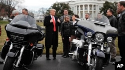 FILE - President Donald Trump give a 'thumbs-up' as he meets with Harley Davidson executives and union representatives on the South Lawn of the White House in Washington, Thursday, Feb. 2, 2017. (AP Photo/Pablo Martinez Monsivais)