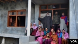 Naeem's only surviving uncle (top left), Muhammad Shaban Butt, with his wife Fazzi (sitting third from left) and other members of their family at their house in the village of Khaitangan in Indian Kashmir's Baramulla district.