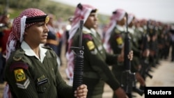 FILE - Jordanian soldiers attend the funeral of Jordanian Captain Rashed Zyoud, who was killed during a raid in Irbid conducted by the Jordanian security forces on Islamic State militants, in Zarqa, Jordan, March 2, 2016.