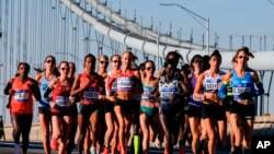 Elite women runners cross the Verrazano-Narrows Bridge during the New York City Marathon on Sunday, Nov. 4, 2018, in New York. (AP Photo/Eduardo Munoz Alvarez)
