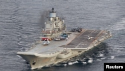 A photo taken from a Norwegian surveillance aircraft shows Russian aircraft carrier Admiral Kuznetsov in international waters off the coast of northern Norway, Oct. 17, 2016.