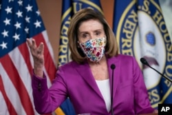 Speaker of the House Nancy Pelosi, D-Calif., holds a news conference on the day after violent protesters loyal to President Donald Trump stormed the U.S. Congress, at the Capitol in Washington, Jan. 7, 2021.
