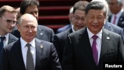 中国国家主席习近平和俄罗斯总统普京2019年6月14日在比什凯克出席上海合作组织峰会。