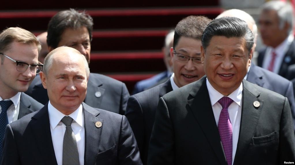中国国家主席习近平和俄罗斯总统普京2019年6月14日在比什凯克出席上海合作组织峰会。(路透社)