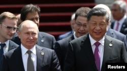 中國國家主席習近平和俄羅斯總統普京2019年6月14日在比什凱克出席上海合作組織峰會。(路透社)