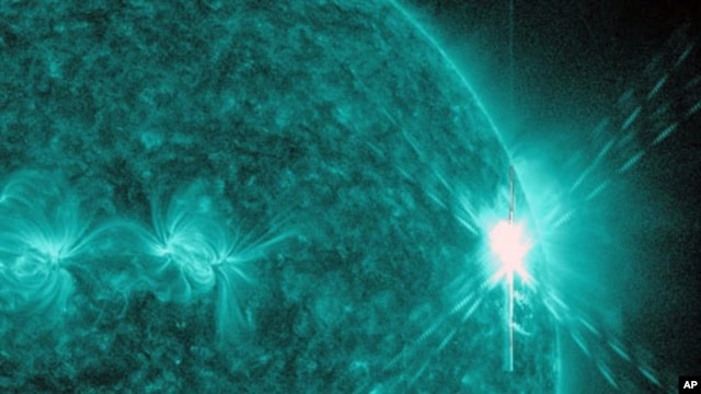 This image provided by NASA shows a solar flare, the largest in 5 years. The image was was captured by NASA's Solar Dynamics Observatory (SDO) in extreme ultraviolet light at 131 Angstroms.  Scientists say the bursts of radiation hurled by the solar blast