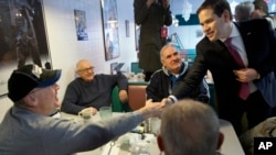 Senator Marco Rubio, a Republican presidential candidate, greets diners at Norton's Classic Cafe while campaigning in Nashua, New Hampshire, Feb. 8, 2016.