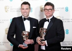 "Stephen Beresford (L) and David Livingstone celebrate after winning the award for outstanding debut by a British writer, director or producer for ""Pridel"" at the British Academy of Film and Arts (BAFTA) awards ceremony at the Royal Opera House in London, Feb. 8, 2015."