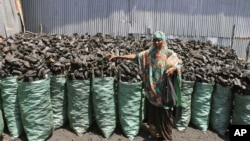 Sacks of dark charcoal sit atop one another in Somalia's southern port city of Kismayo, an industry once worth some $25 million dollar a year to al-Qaida-linked insurgents, Oct. 30, 2012.