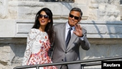 We're not suggesting that U.S. actor George Clooney and his wife Amal Alamuddin do not have stress. But a new study finds their stress might be better. Here the couple leave a seven-star hotel in Venice, Italy, 2014.( REUTERS/Stefano Rellandini)
